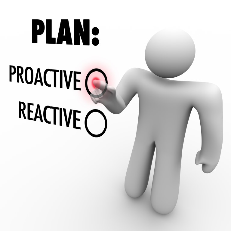A man presses a button beside the word Proactive instead of Reactive symbolizing the choice to take action and make improvements