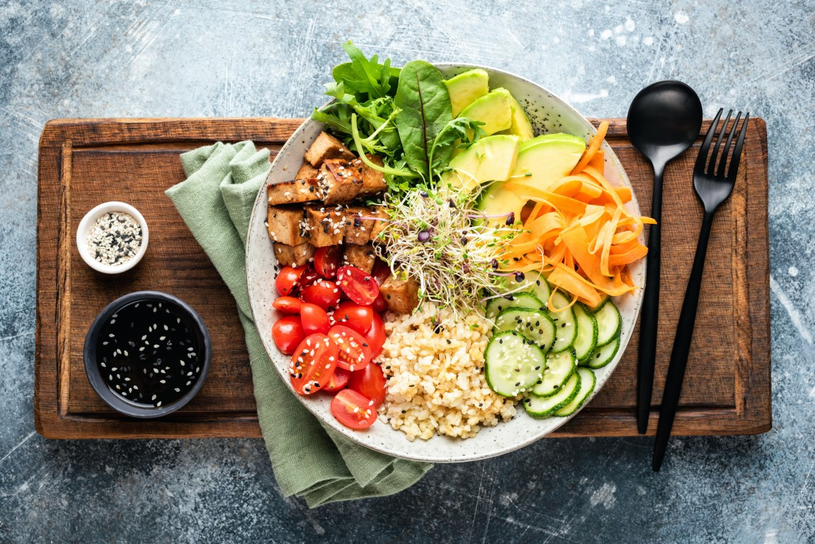 A healthy salad of Tofu, Avocado, Bulgur Grains, Cucumber, Carrot